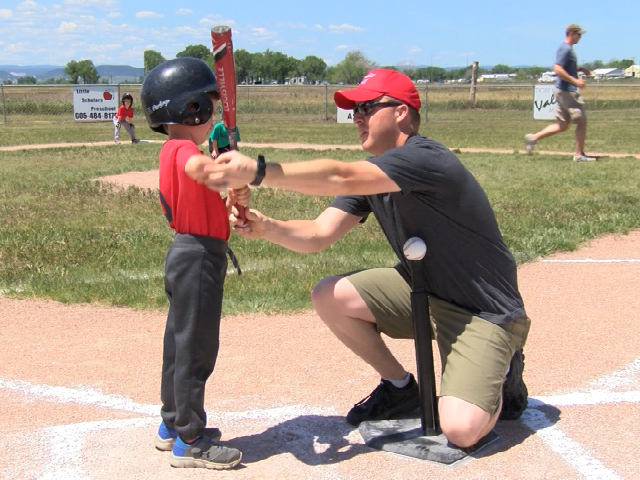 Ellsworth airmen volunteers and influences kids as a t-ball coach