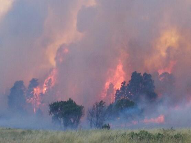 large wild land fire growing in Wanblee SD, July 16