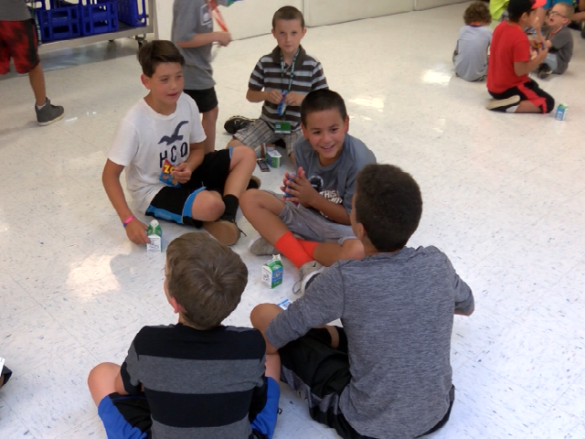 © A group at the Club for Boys enjoys a free snack. The Club for Boys is offering free meals to non-members, thanks to a donation. Photo Date: July 17, 2017