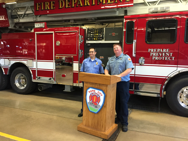 Firefighters talk to students for Fire Prevention Week