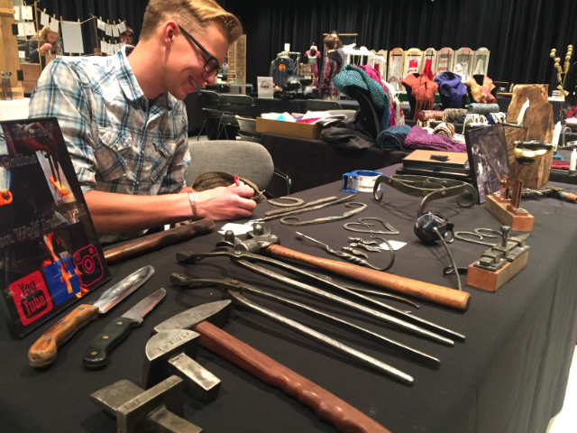 © Artists preparing table for the annual Holiday Art Market. Nov. 17,2017