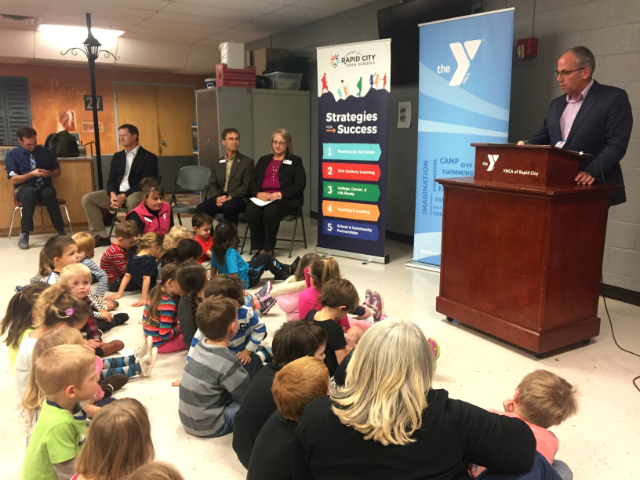 © Mayor Steve Allender discusses partnership expansion between RCAS and the YMCA during a press conference. Nov. 21,2017