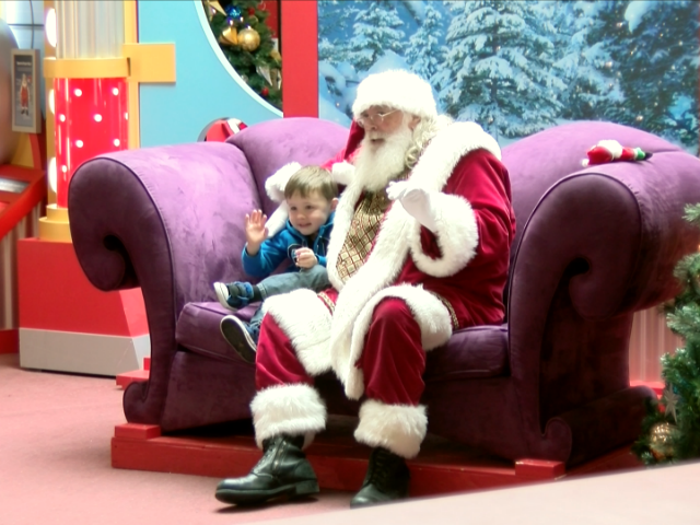 Caring Santa visits with children with special needs